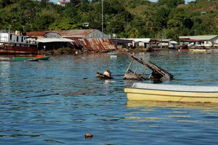 Photographs of the April 2007 tsunami damage at Gizo, Solomon Islands, by John and Tracy and taken from their boat, Prossie Joe